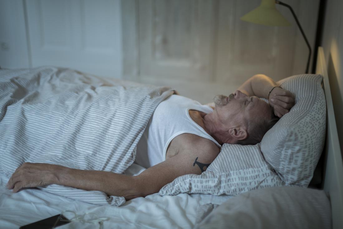 bearded man asleep in bed