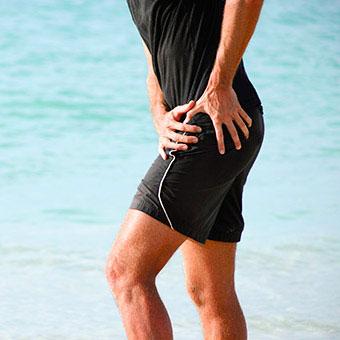 A runner experiences sacroiliac (SI) joint pain.