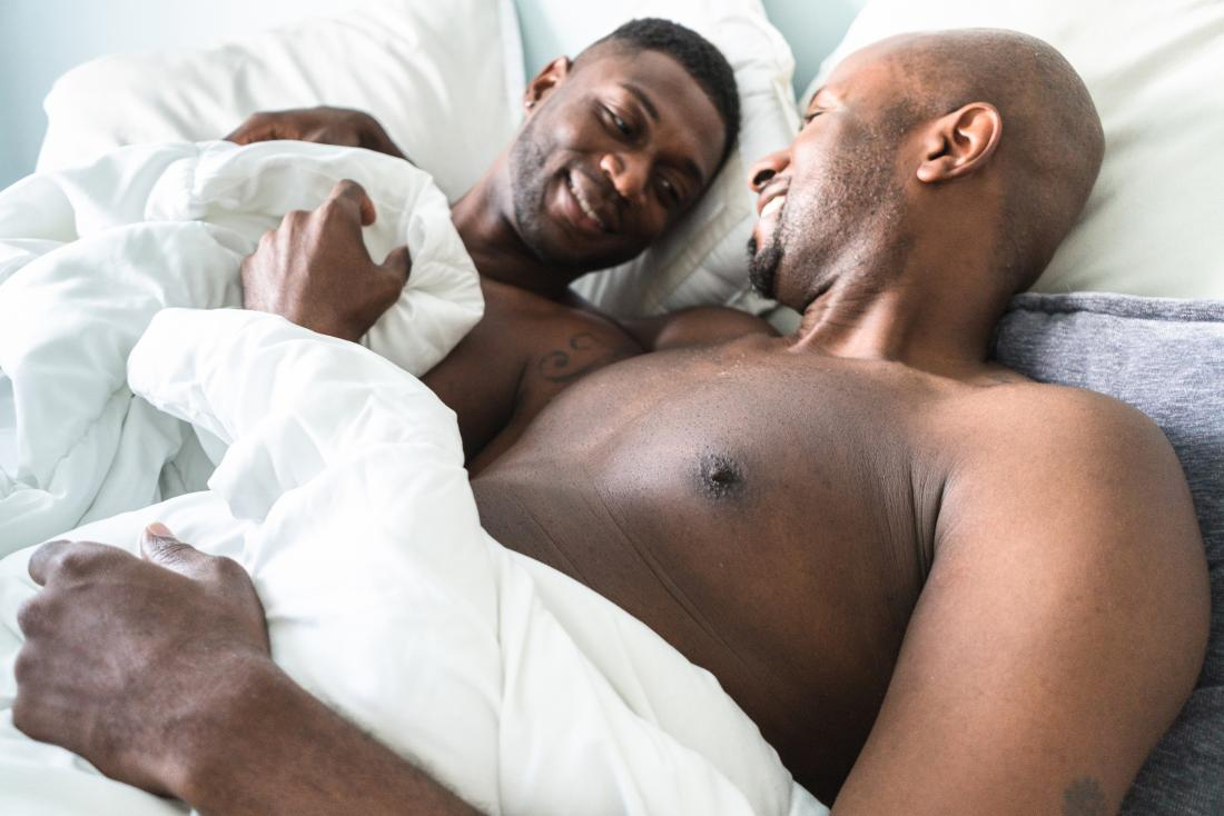 Two men sleeping naked together
