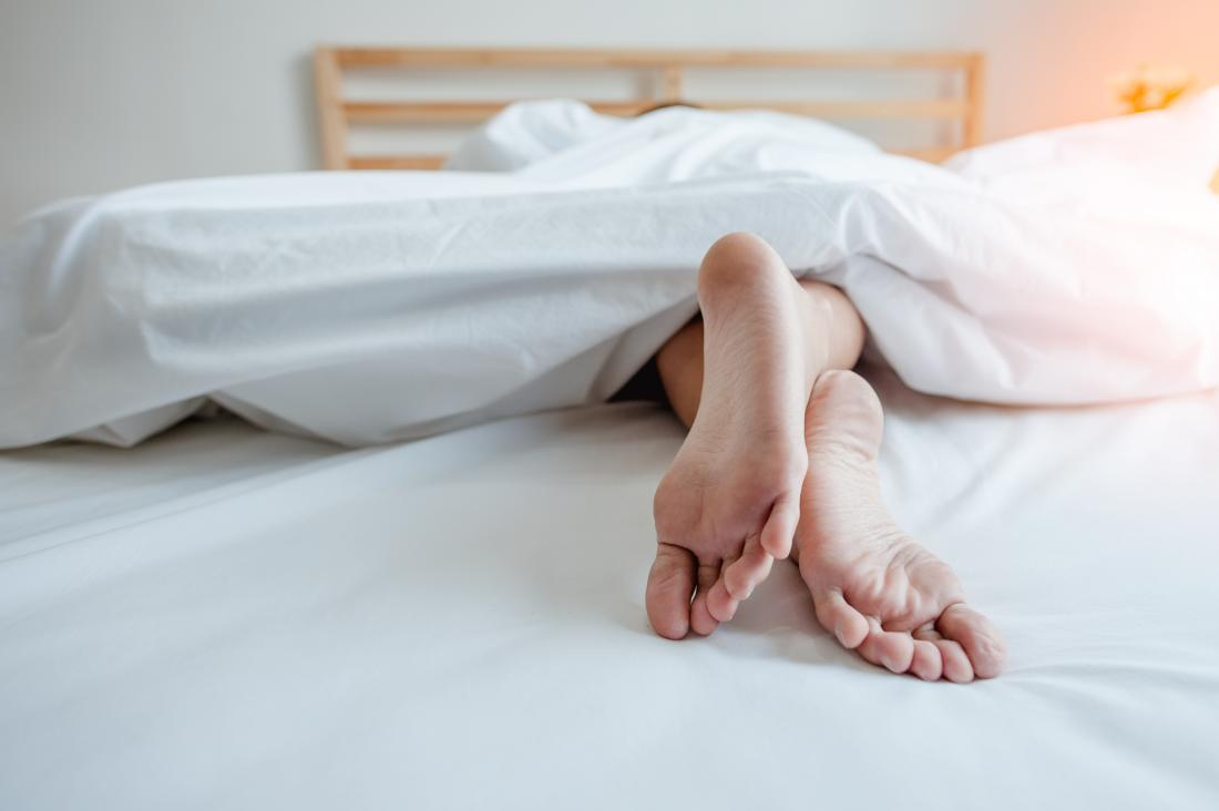 Woman sleeping naked in bed