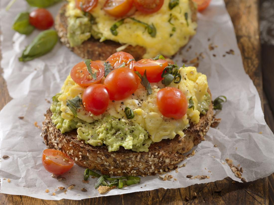 Scrambled eggs, avocado and tomatoes on whole grain bread which may be recommended for an adhd diet