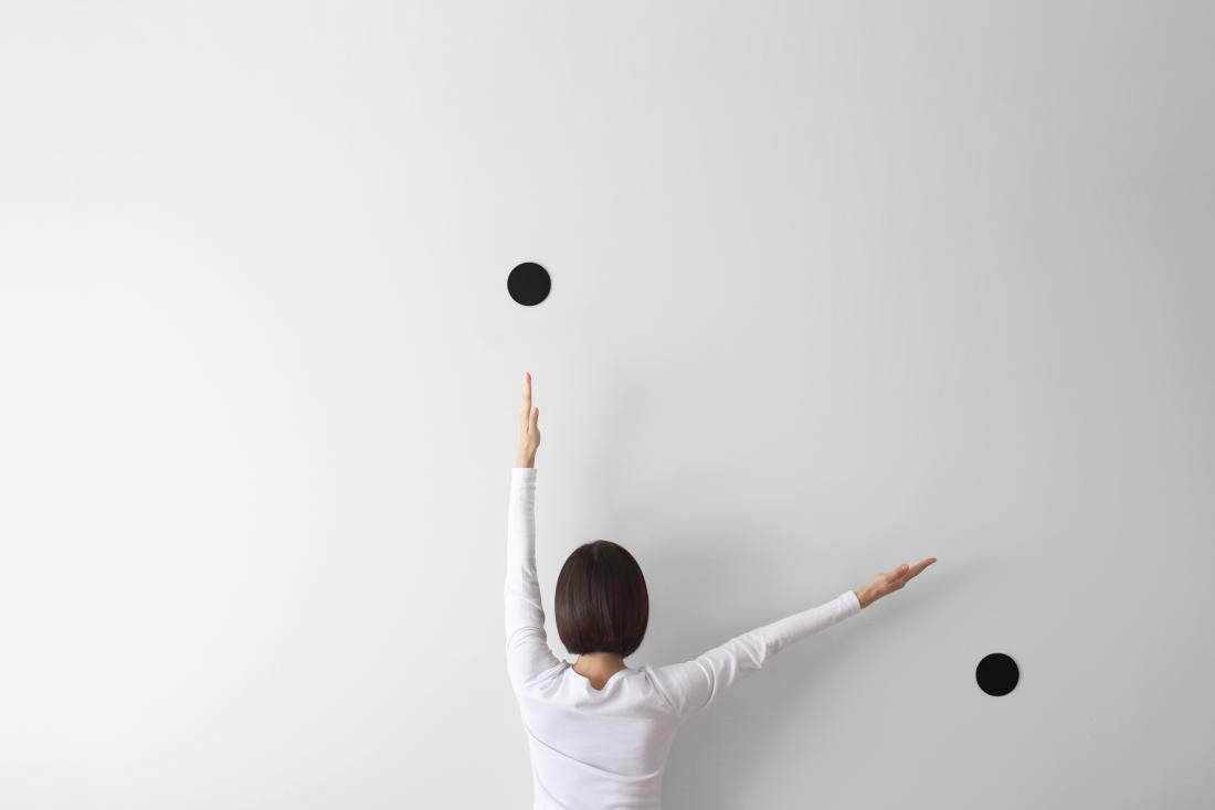 person facing wall simulating a clock