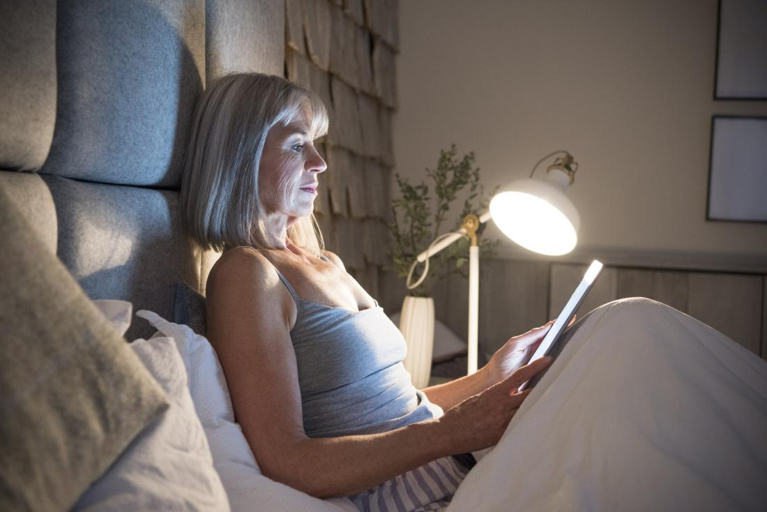 woman reading in bed at night