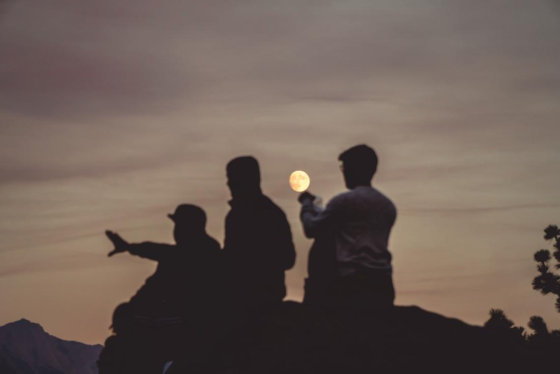 three silhouettes in the moonlight