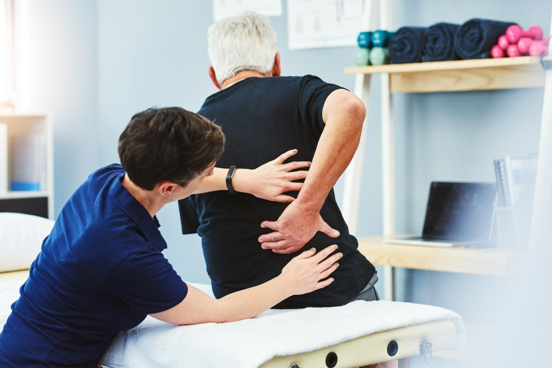 Person with back and hip pain having physical therapy