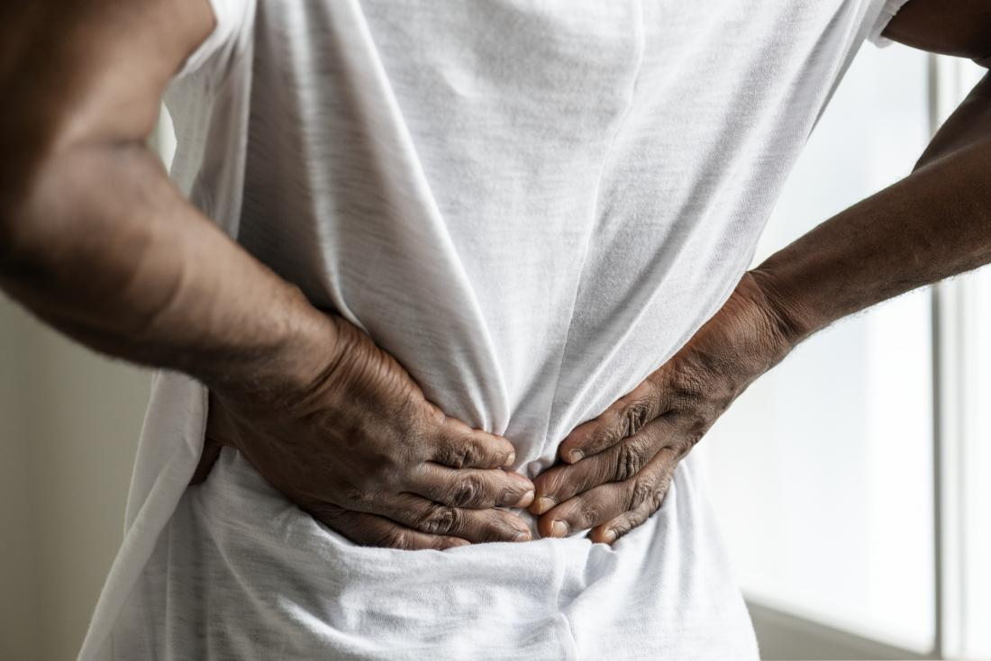 Person experiencing lower back pain.
