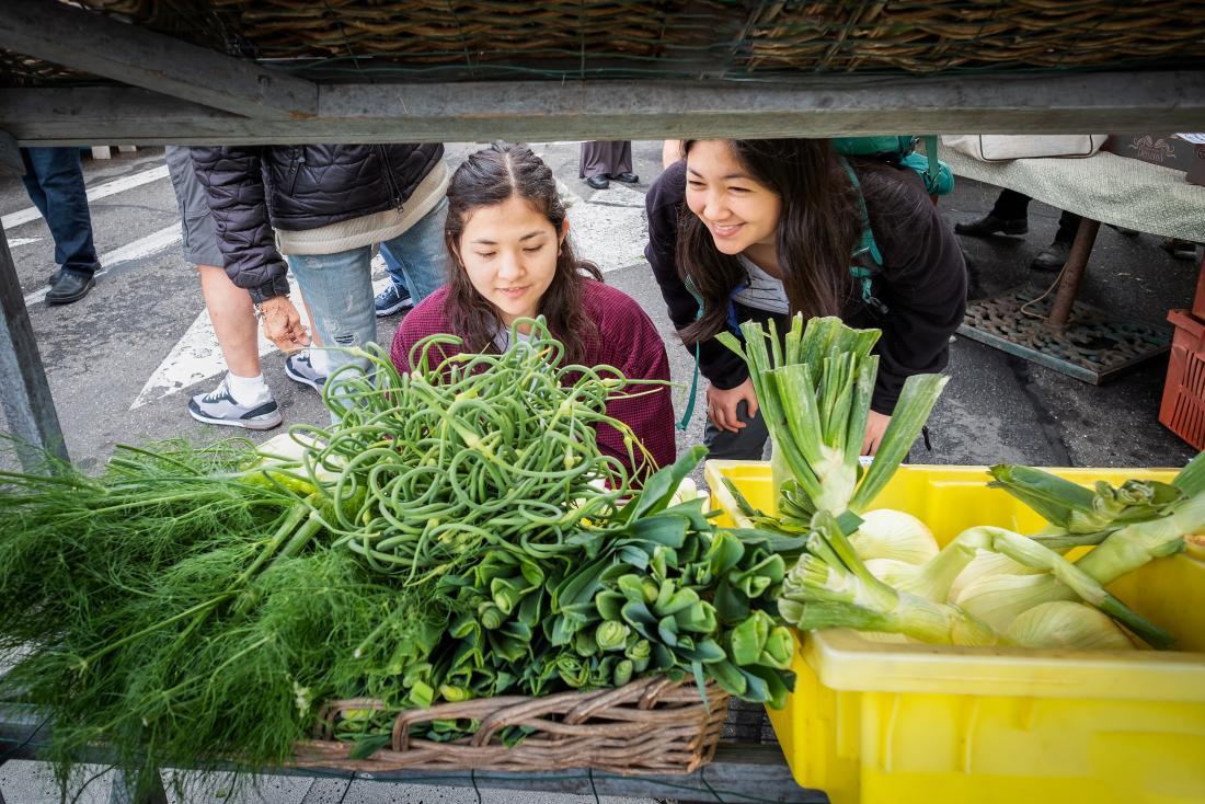 Girls shopping for veg