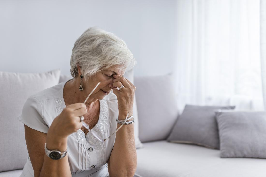 Woman with a headache and fatigue due to secondary progressive multiple sclerosis