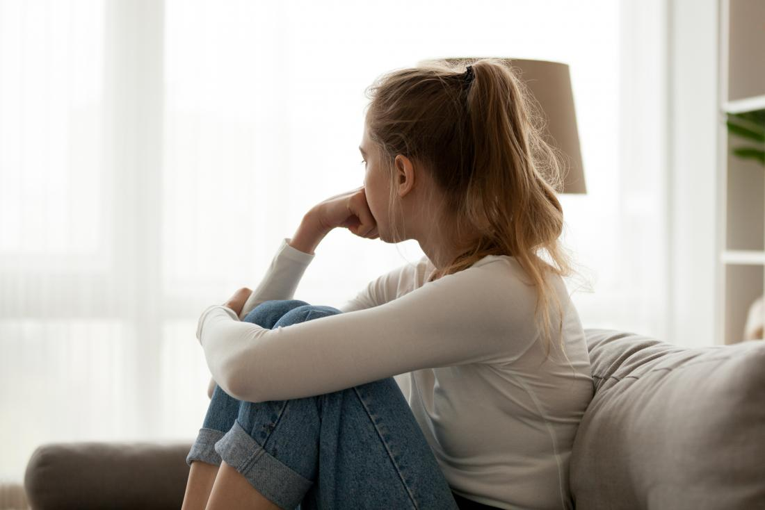 Woman on the sofa thinking about secondary progressive multiple sclerosis