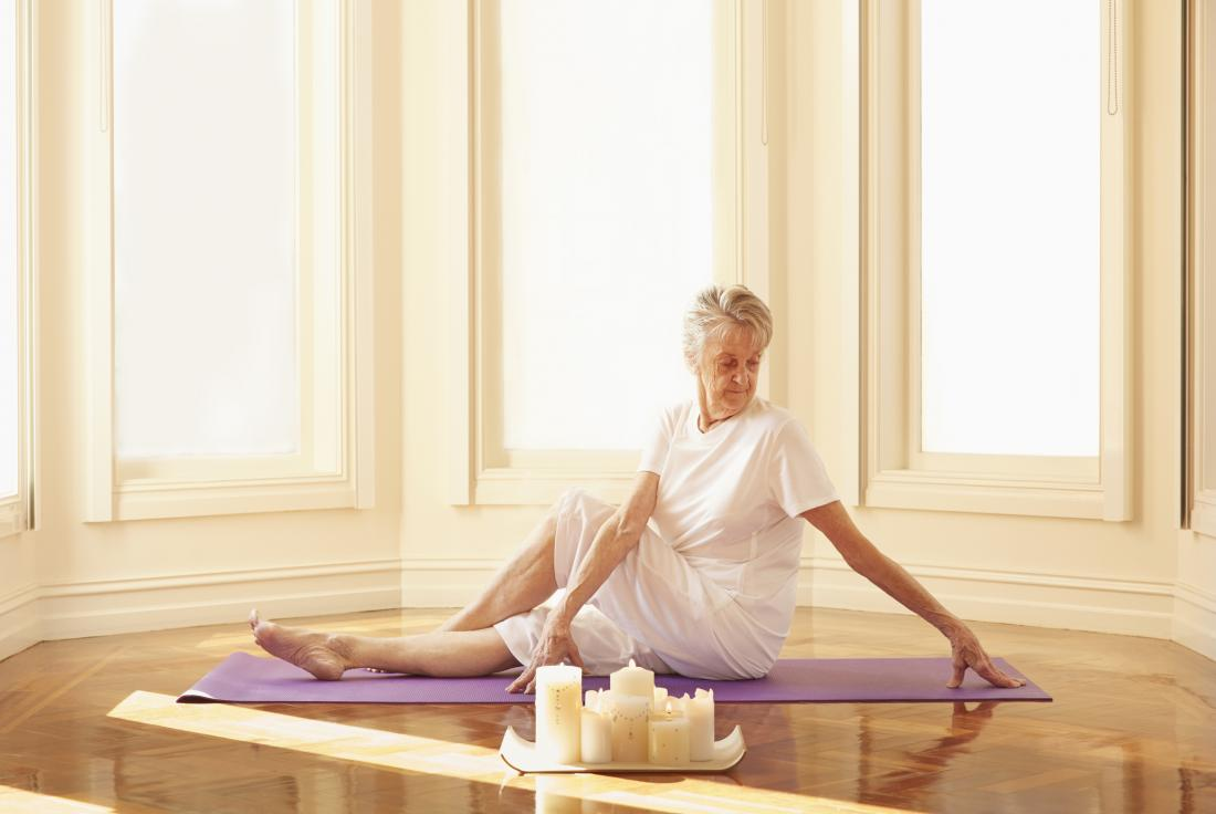 older woman practicing yoga