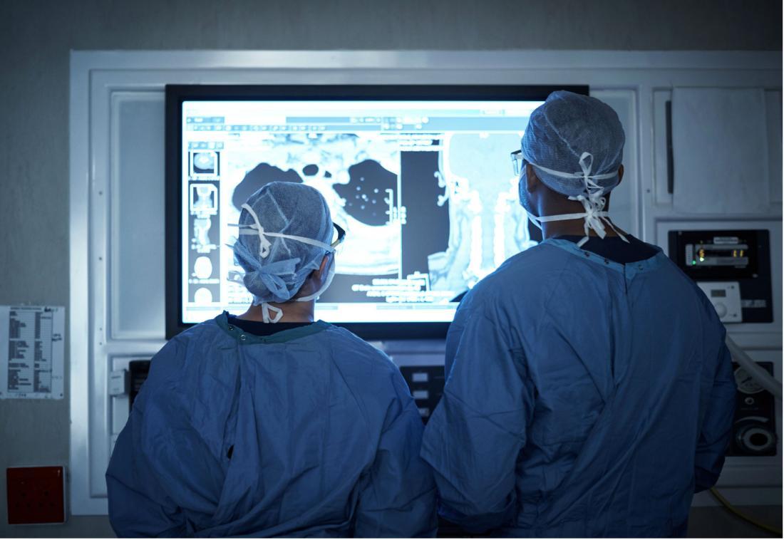 surgeons looking at a screen