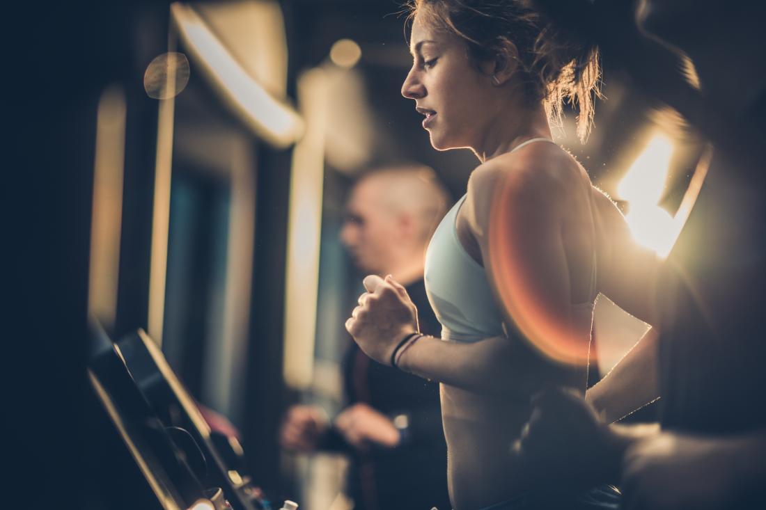 woman running on a treadmill