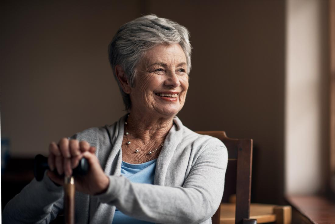 smiling older woman with cane