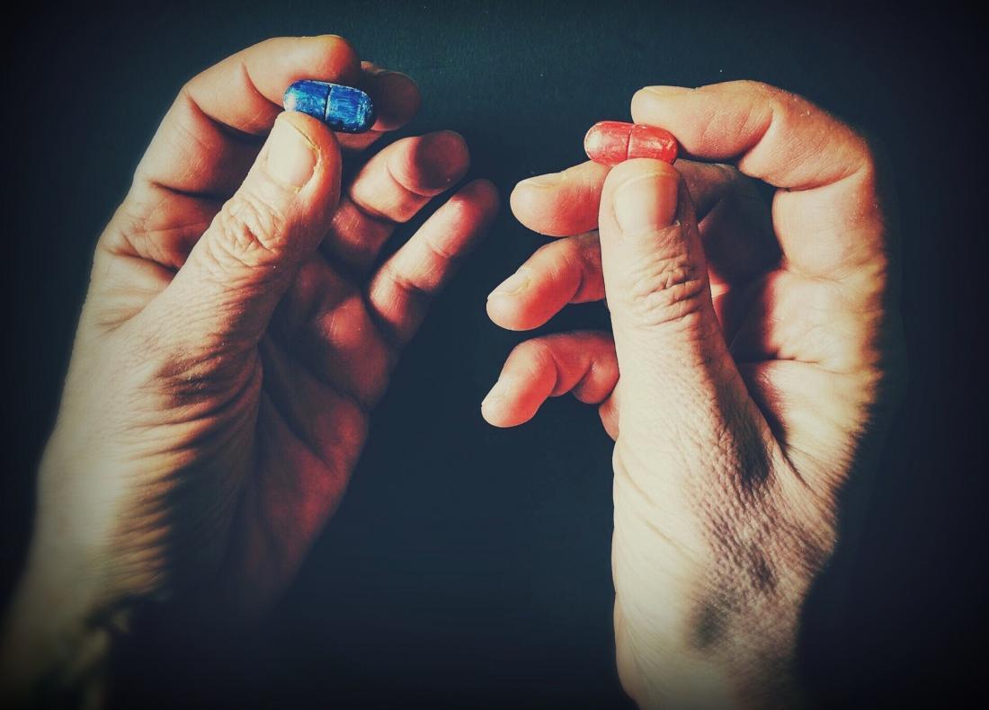 Hands holding pills