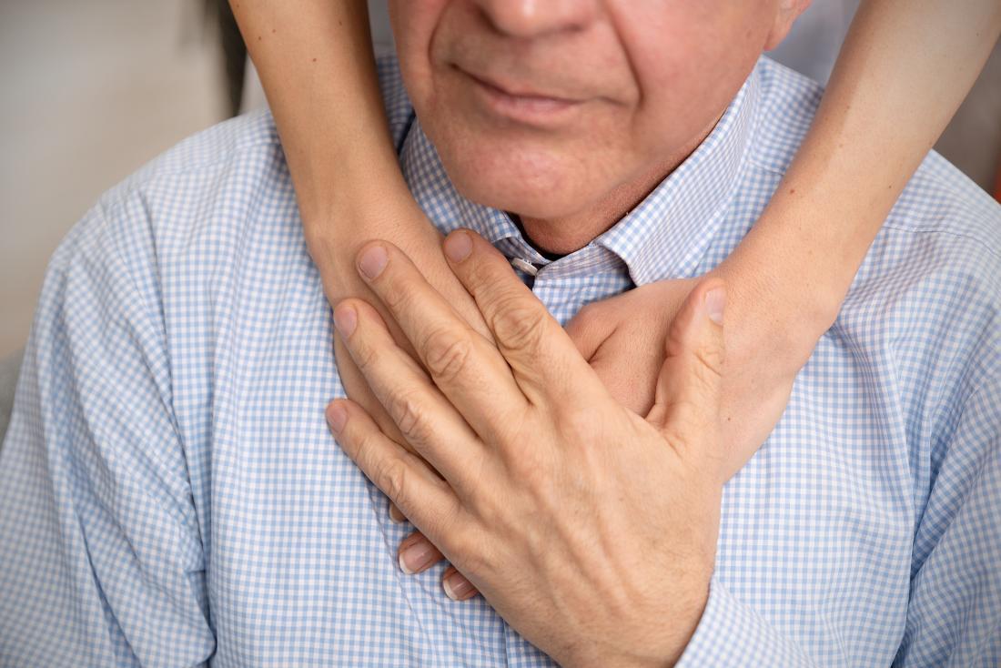 Older adult being comforted