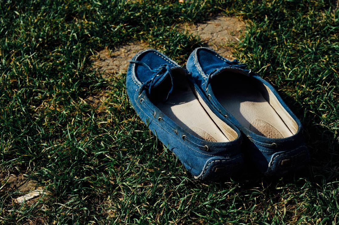 picture of blue moccasins on grass