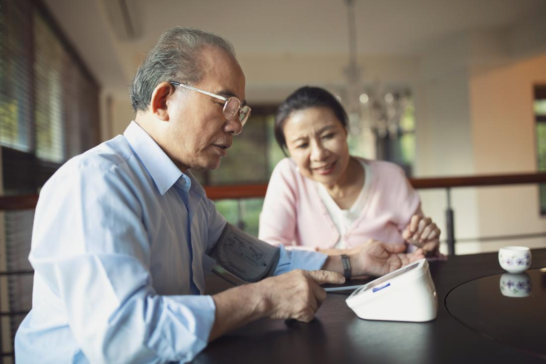 senior monitoring his blood pressure