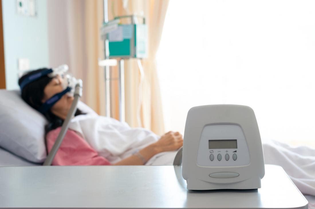 woman sleeping with sleep apnea machine