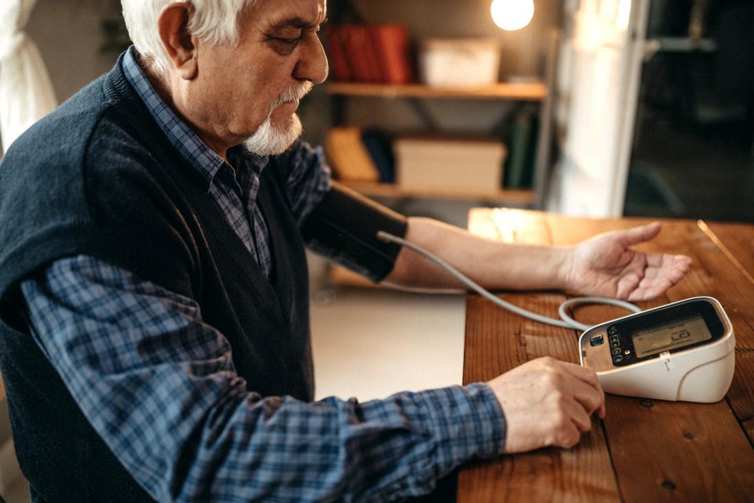 Man checking blood pressure