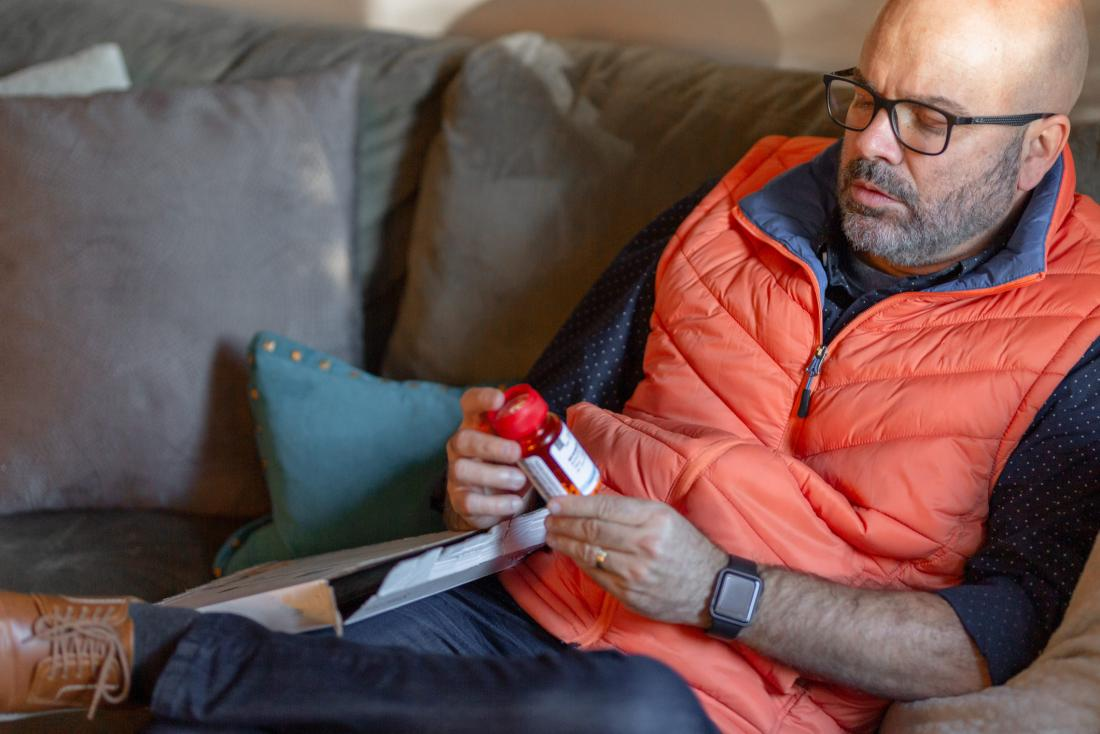 Man reading pill bottle