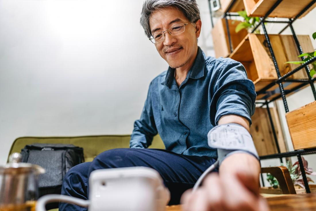 man taking his blood pressure