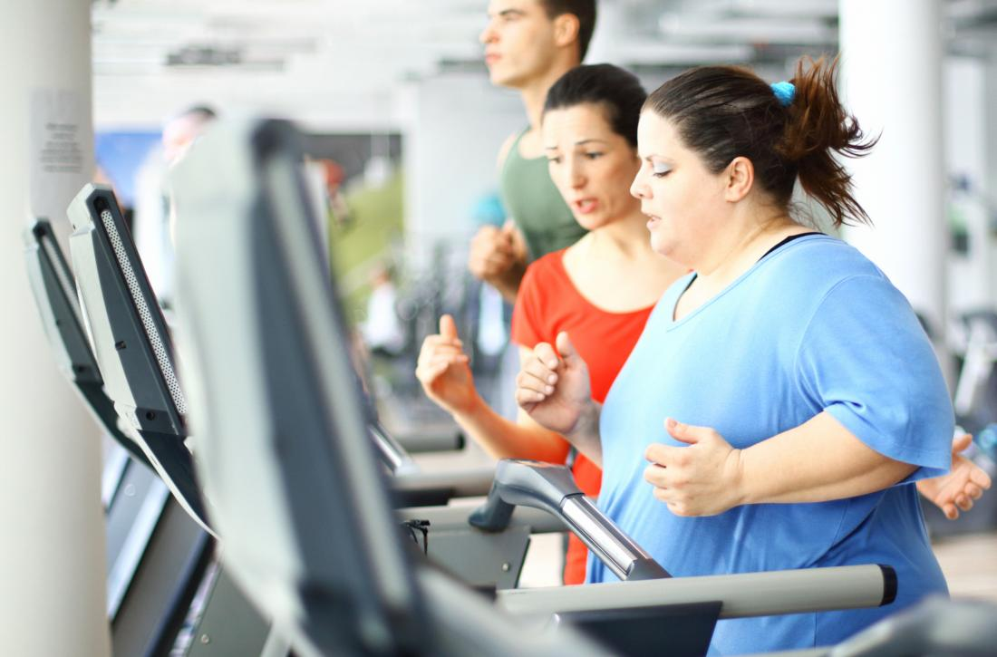 obese woman running on treadmill
