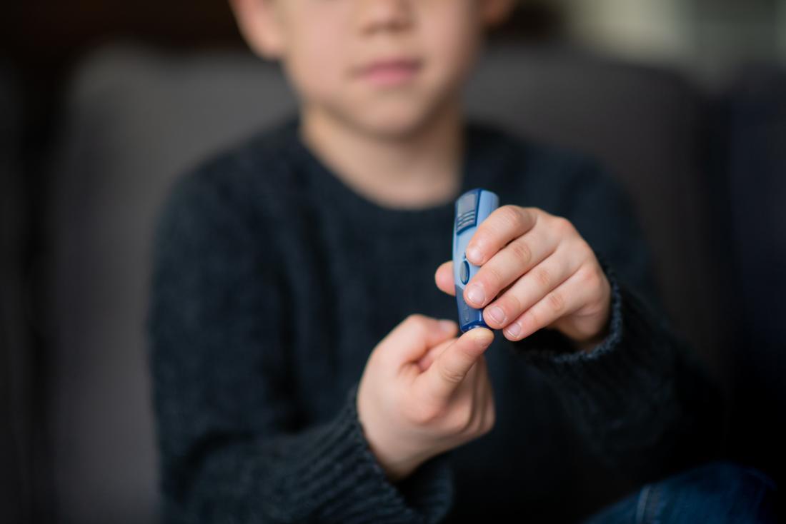 child taking his blood sugar