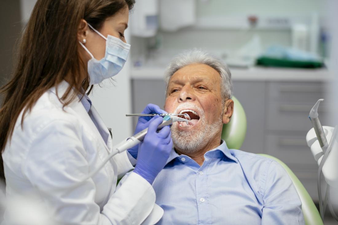 senior man at the dentist