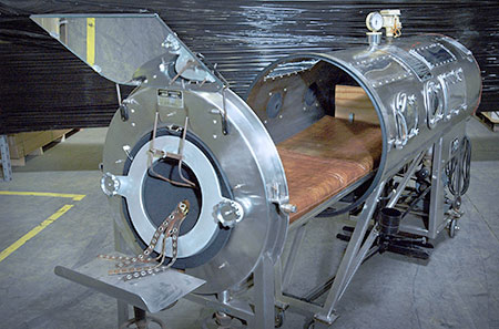 Picture of iron lung used to move air in and out of lungs by pressure changes