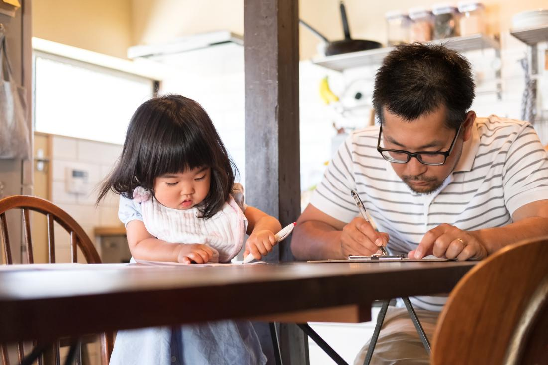 father and daughter writing together