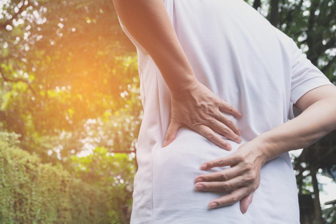 person seen from the back, having back pain