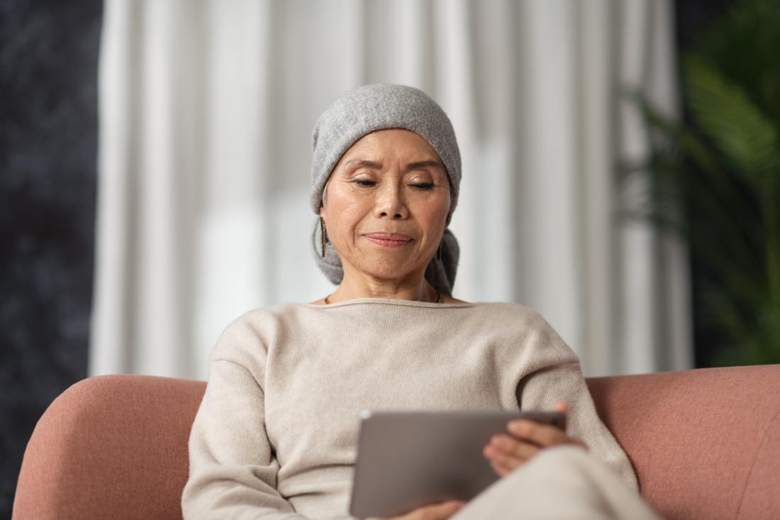 woman reading something on a tablet