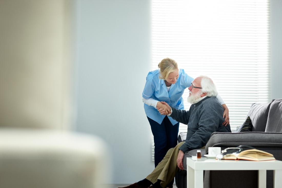 senior man being helped by carer
