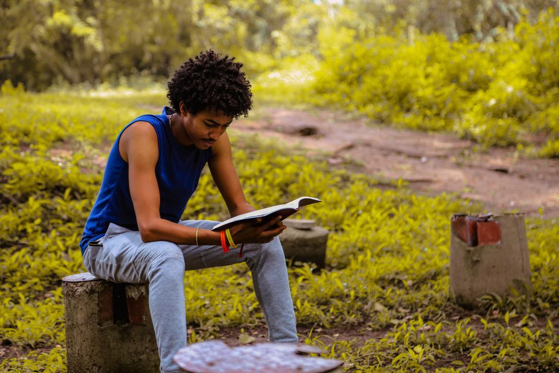man reading in park