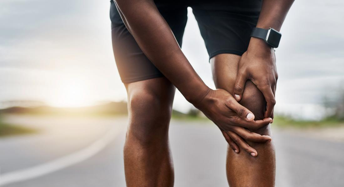 close up of runner's painful knee