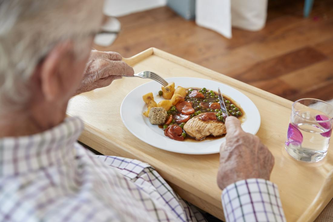 Older adult eating dinner