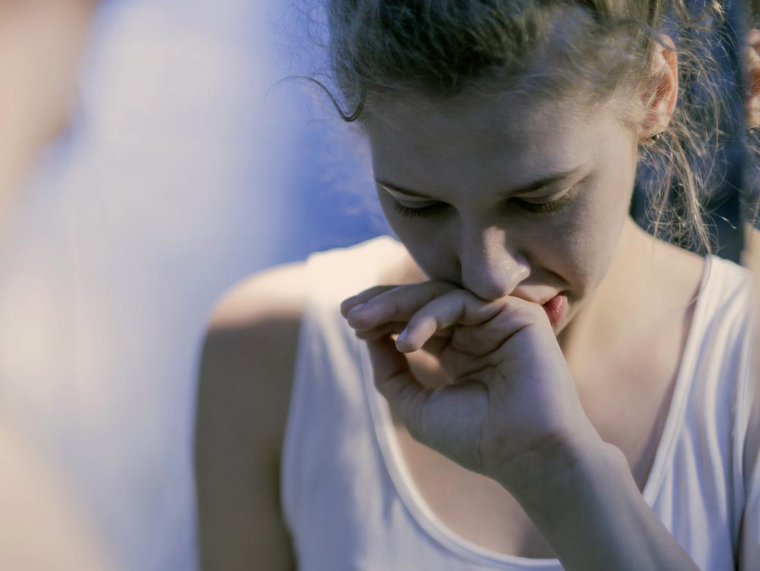 a woman experiencing nausea because of annabinoid hyperemesis syndrome