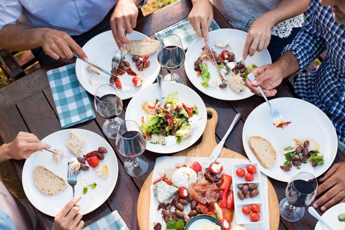 people eating various foods