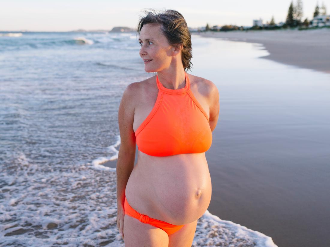 a mature pregnant woman on beach