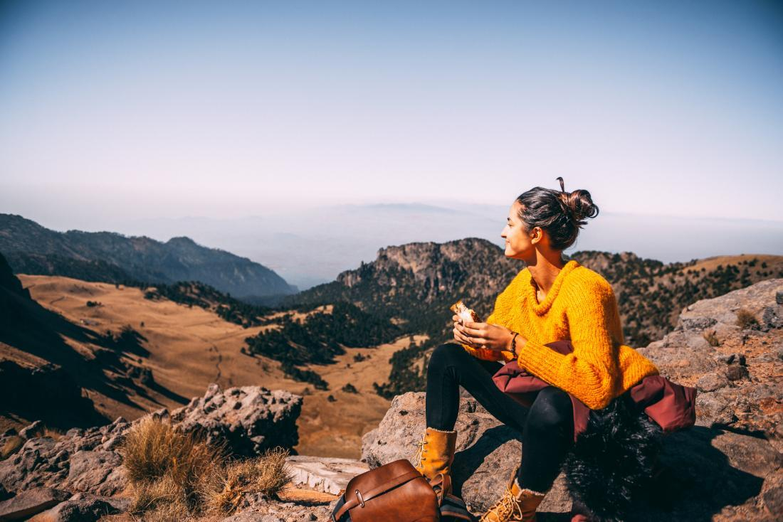 woman eating in nature