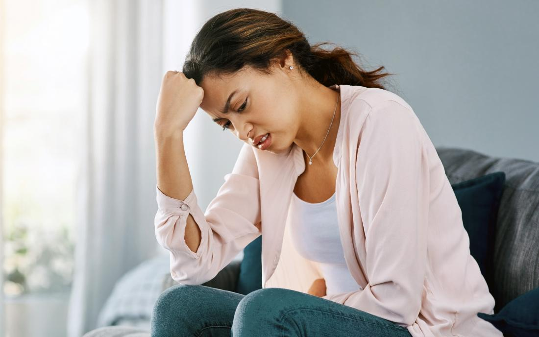 a woman experiencing constipation possibly from her keto diet.