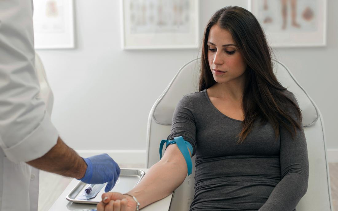 a woman having a blood test for Crohns disease
