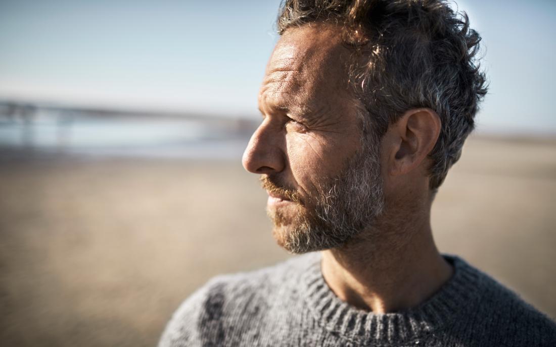 a man looking pensive as he has Lymphoma rash
