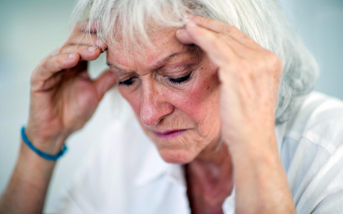 a woman experiencing a headache because of Microvascular ischemic disease
