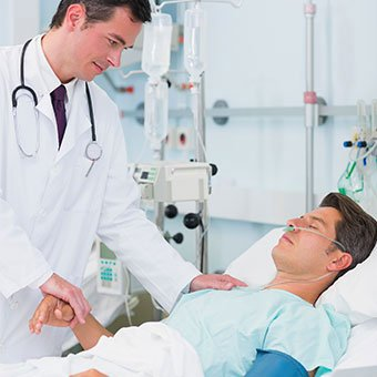 A doctor consults with a MRSA patient in the hospital.
