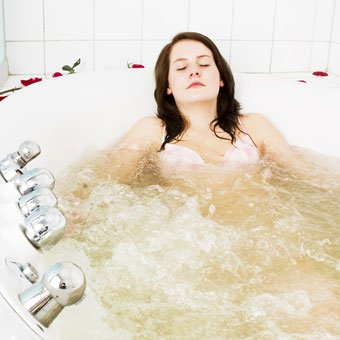 A woman taking a bath to ease her restless leg syndrome pain.