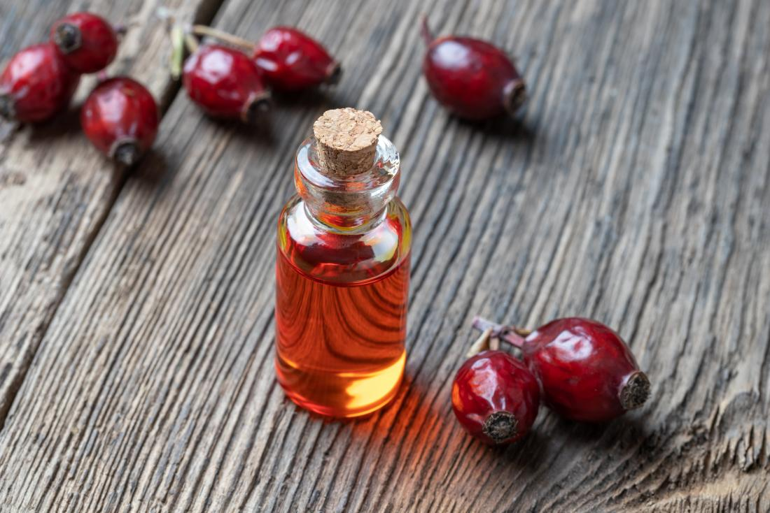 a vial of rosehip oil that can be used on the face.