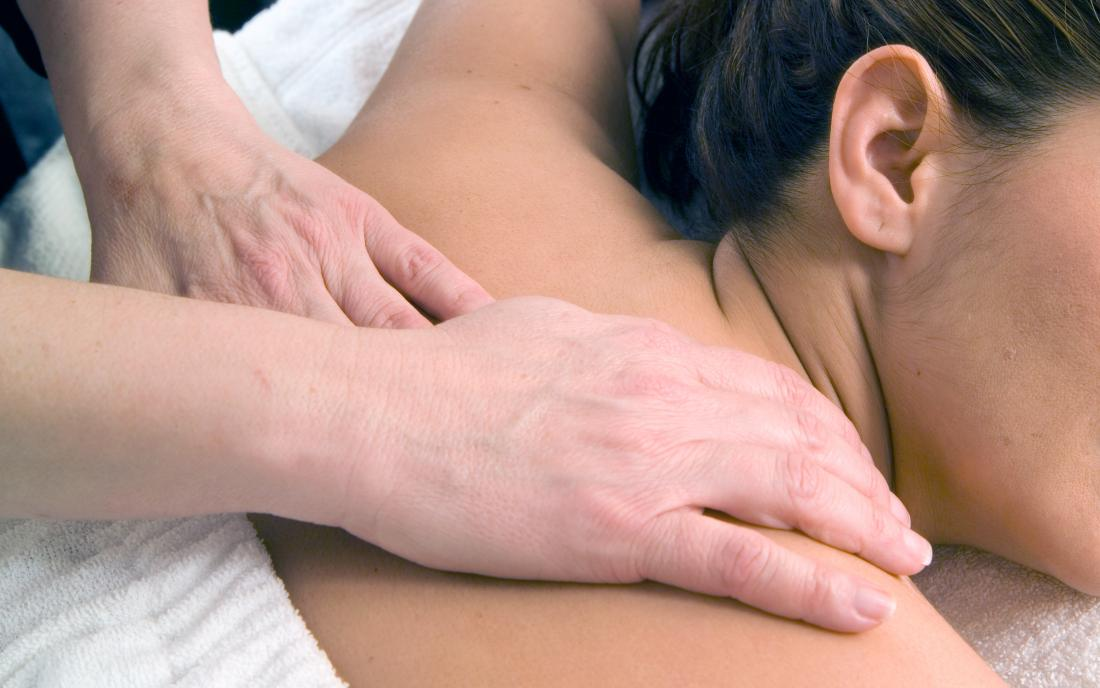 a woman receiving either a swedish massage or deep tissue