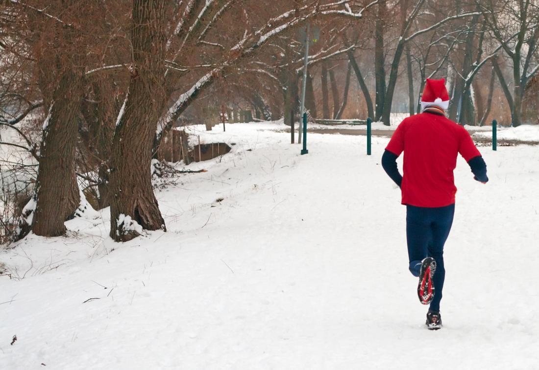 Man running dressed as Santa