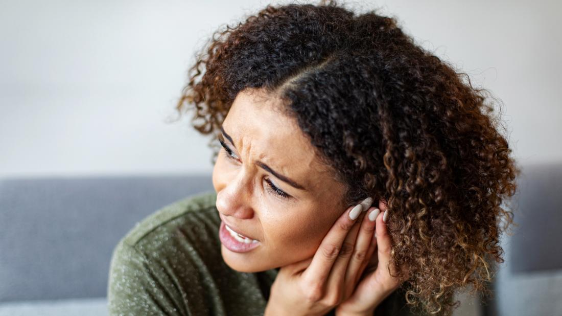a person experiencing a headache and tinnitus because of a CSF leak